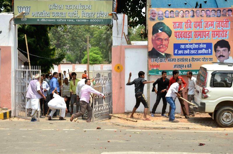 BJP workers pelt stones on RJD workers protesting outside BJP office in Patna on May 17, 2017. At least half a dozen persons were injured in the violent clash between RJD and BJP workers a day ...