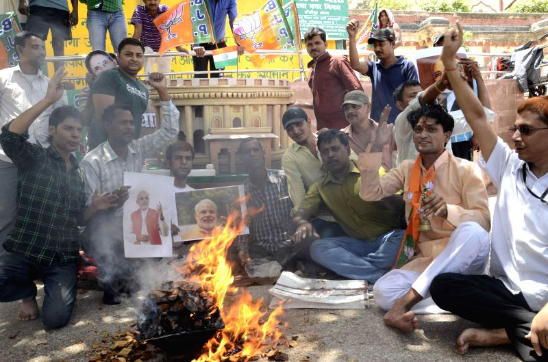 BJP workers perform 'hawan' in front of a replica of Parliament in Patna on May 15, 2014.