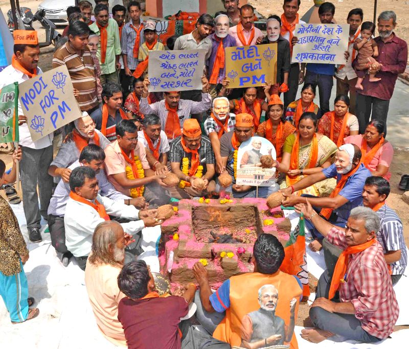 BJP workers performing yagna to make BJP Prime Ministerial candidate and Gujarat Chief Minister Narendra Modi as Prime Minister of India at Vastral area in Ahmedabad on April 19, 2014.