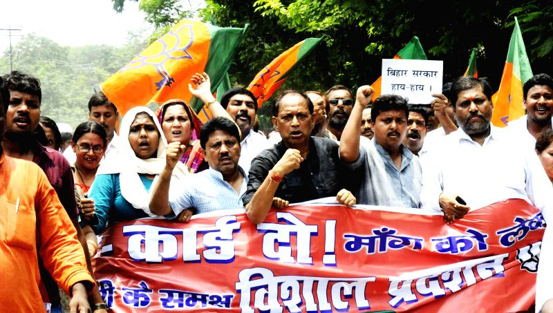 BJP workers protest against Bihar government in Patna on June 28, 2014.