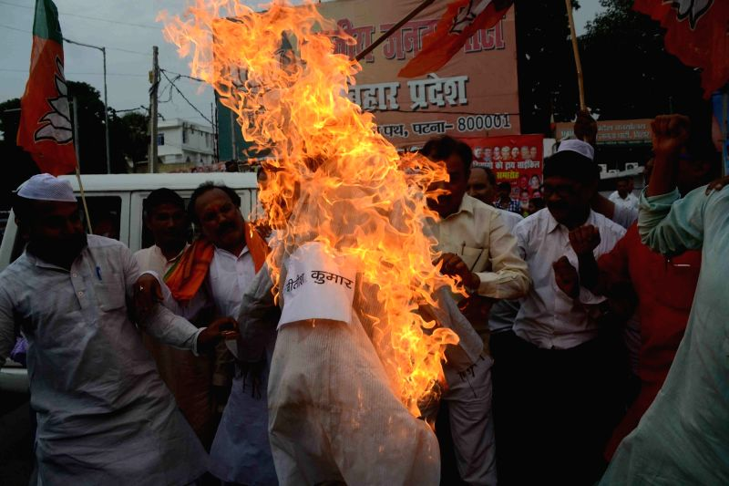 BJP workers stage a demonstration after a Pakistani flag was hoisted in Nalanda district; in Patna on July 21, 2016.