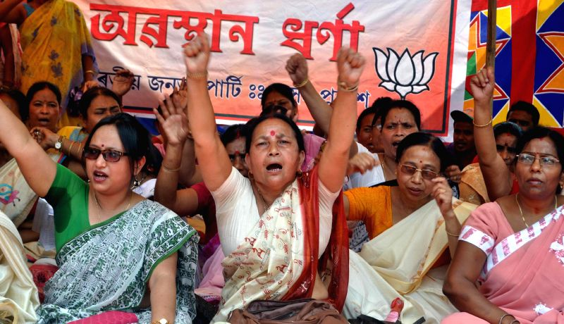 BJP workers stage a demonstration against Congress in front of Raj Bhawan in Guwahati on April 28, 2014.