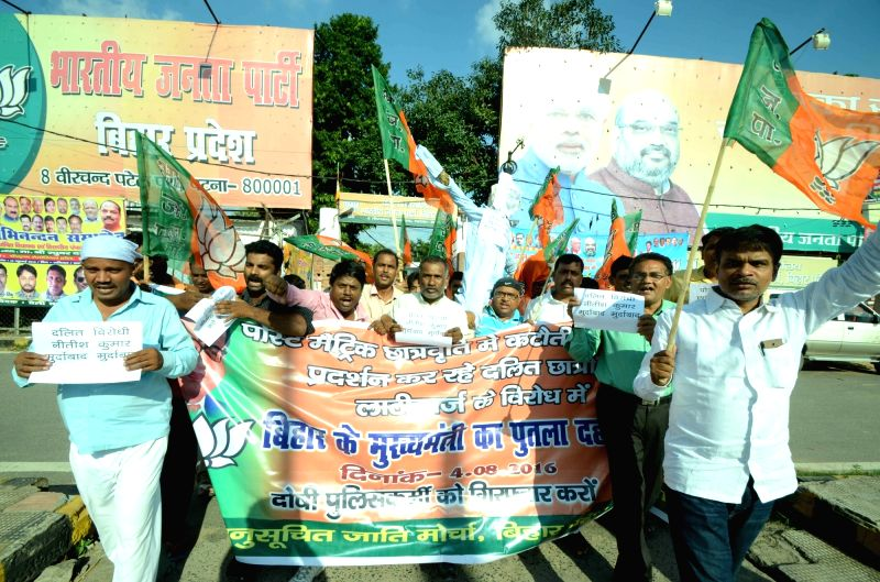 BJP workers stage a demonstration against Bihar government in Patna on Aug 4, 2016.