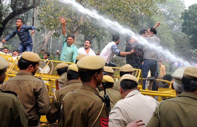 BJP workers stage a demonstration against Delhi Chief Minister Arvind Kejriwal in New Delhi, on Nov 27, 2015. - Arvind Kejriwal