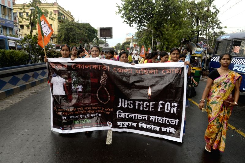 BJP workers stage a demonstration against the killings of two party workers in Purulia district of West Bengal; in Kolkata on June 9, 2018.