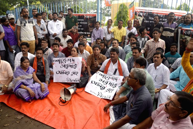 BJP workers stage a demonstration against TMC, in Kolkata on July 28, 2018.