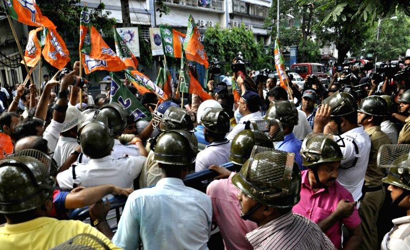 BJP workers stage a demonstration against West Bengal Government for violence in civic polls in front of State Election Commission office in Kolkata on May 15, 2017.