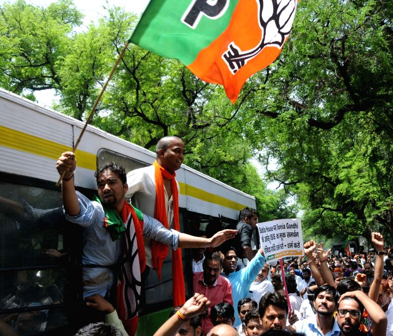 BJP workers stage a demonstration outside Congress Headquarters in New Delhi, on May 30, 2016.