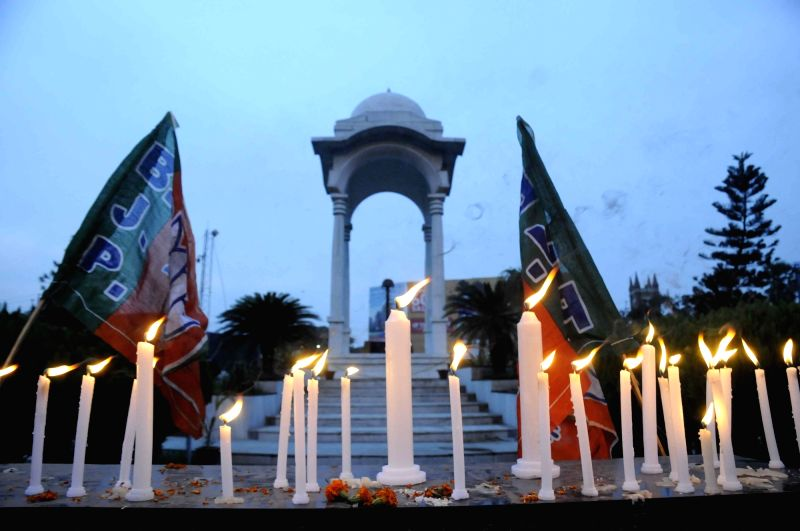 BJP workers take out a candle march to pay tribute to 10 CRPF troopers gunned down by Maoist; at Kargil Chowk in Patna on July 20, 2016.