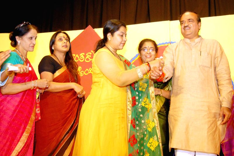 BJP workers tie rakhi on the wrist of BJP leader and Union Chemicals and Fertilizer Minister Ananth Kumar during a programme organised on Raksha Bandhan in Bangalore on Aug 10, 2014. - Ananth Kumar
