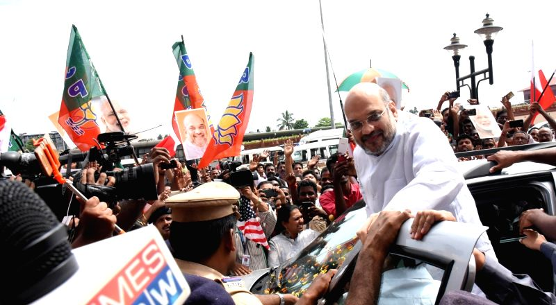 BJP workers welcome party chief Amit Shah at Cochin International Airport on June 2, 2017. - Amit Shah