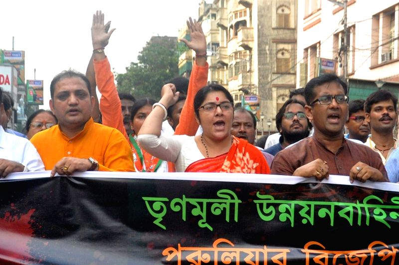 BJP Yuba Morcha activists led by party's Mohila Morcha President Locket Chatterjee take out a protest rally over the alleged killing of BJP activists in Purulia; in Kolkata on June 2, 2018. - Chatterjee