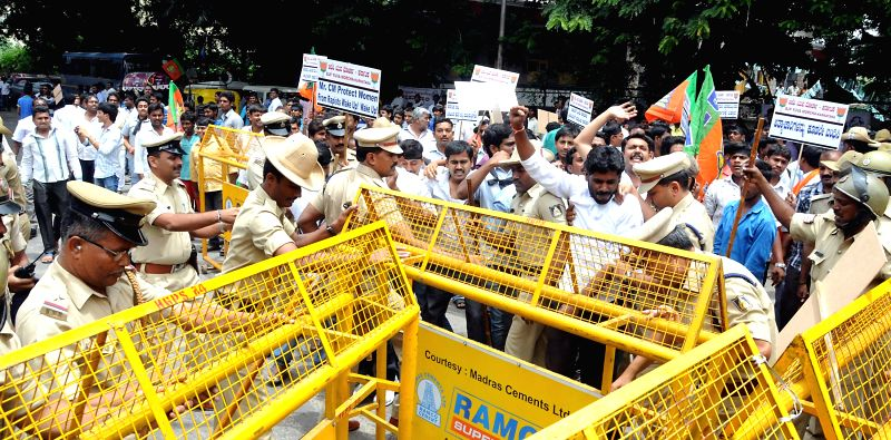 BJP Yuva Morcha activists being arrested by police during a demonstration against alleged rape of a 6-year-old student in Bangalore on July 21, 2014.