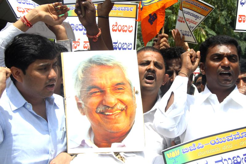 BJP Yuva Morcha activists stage a demonstration against  Kerala Chief Minister Oommen Chandy in Bangalore on July 30, 2014. - Oommen Chandy