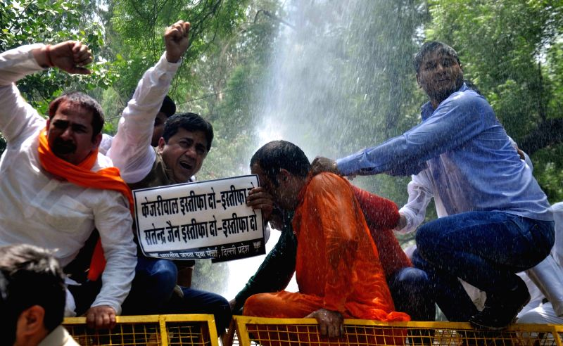 BJP Yuva Morcha activists stage a demonstration outside the Delhi Assembly demanding resignation of Delhi Chief Minister Arvind Kejriwal in New Delhi on May 9, 2017. - Arvind Kejriwal