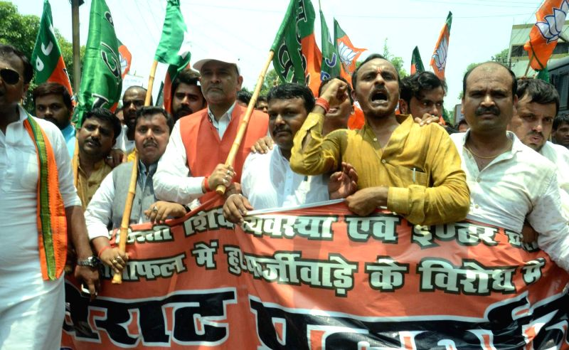 BJP Yuva Morcha activists stage a demonstration to press for their demands in Patna on June 13, 2017.