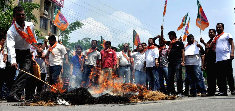 BJYM activists burn effigies of Assam Chief Minister Tarun Gogoi to protest against recent violence in Bodoland Territorial Area Districts (BTAD) of Assam, in Guwahati on May 6, 2014. - Tarun Gogoi