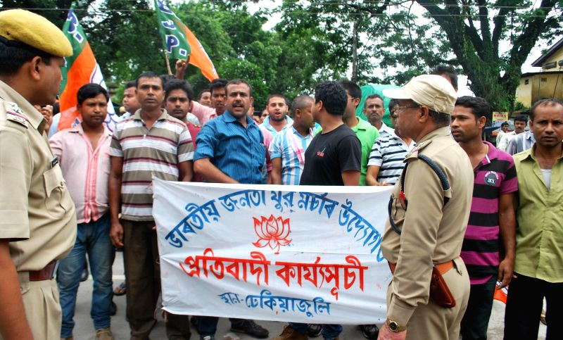 BJYM activists demonstrate against Assam government at Dhekiajuli in Sonitpur district of Assam on June 23, 2014.
