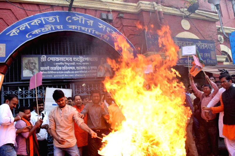BJYM activists stage a demonstration against supply of contaminated water in front Kolkata Municipal Corporation head office in Kolkata on Feb 13, 2018.