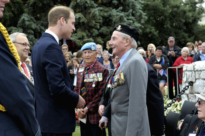 Picture released by New Zealand Government House that Britain's Prince William (L) talking with war veterans after a wreathlaying ceremony at Seymour Square in ...