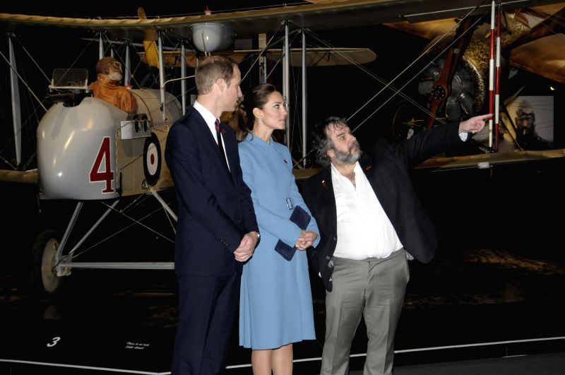 Picture released by New Zealand Government House shows Britain's Prince William (L) and his wife Catherine (C) visiting the Omaka Aviation Heritage Centre with ...