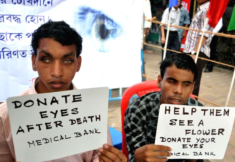 Blind people appeal to donate eyes during `Donate Eyes Restore Sight` a campaign organised on National Eye Donation week in Kolkata on Aug 27, 2014.
