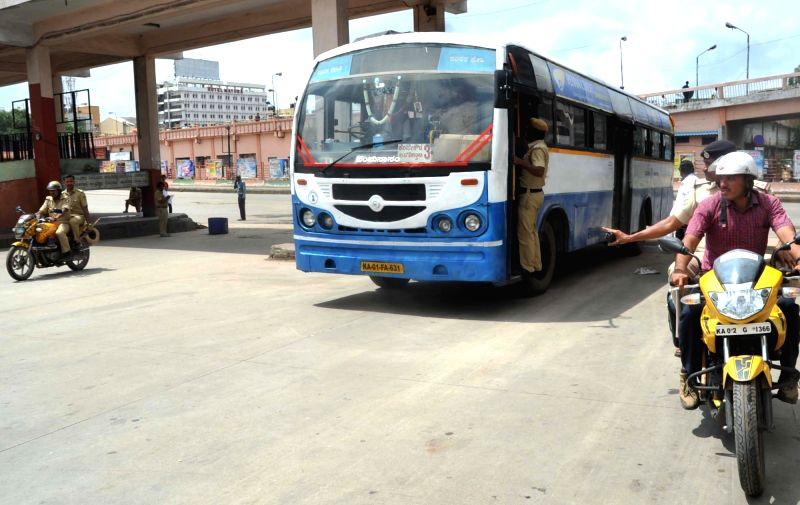 BMTC buses were deployed with drivers in probation along with police escorts from Shanthinagar to Majestic Bus Stand in Bengaluru on July 27, 2016.