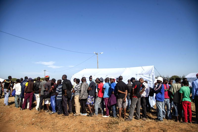 BOANE(MOZAMBIQUE), April 23, 2015 People who return from South Africa queue in the transit center at Boane district, Maputo Province, Mozambique, on April 23, 2015. The Mozambican ...