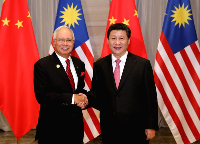 Chinese President Xi Jinping (R) meets with Malaysian Prime Minister Najib Razak in Boao, south China's Hainan Province, March 27, 2015. - Najib Razak