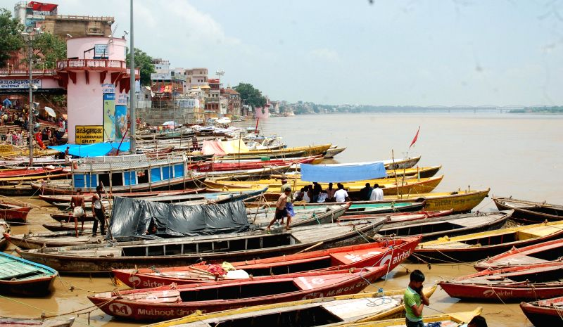 Boats remain anchored on the ghats of Ganga river in Varanasi as water level in the river is increasing; on Aug 7, 2014.
