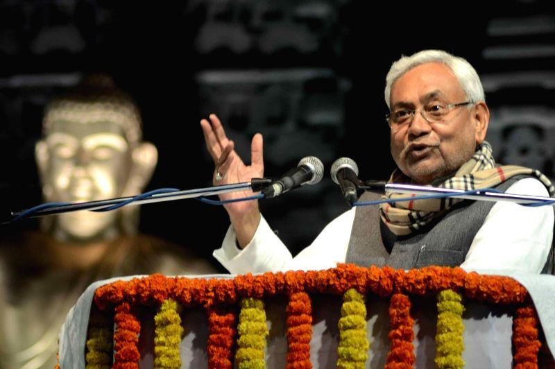 Bodh Gaya: Bihar Chief Minister Nitish Kumar addresses during Buddha Mahotsav at Mahabodhi Temple in Bodh Gaya, Bihar on Feb 1, 2018. - Nitish Kumar