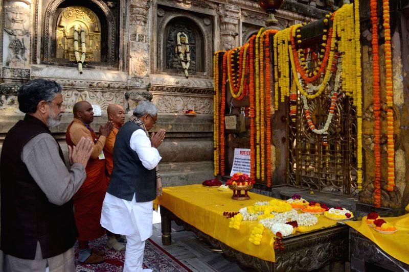 Bodh Gaya: Bihar Chief Minister Nitish Kumar and Deputy Chief Minister Sushil Kumar Modi offer prayers at Mahabodhi Temple in Bodh Gaya, Bihar on Feb 1, 2018. - Nitish Kumar and Sushil Kumar Modi