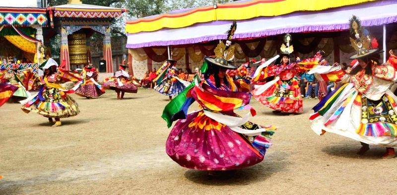 Artists dance for world peace at Bhutan temple in Bodhgaya, Bihar on Jan 13, 2015.