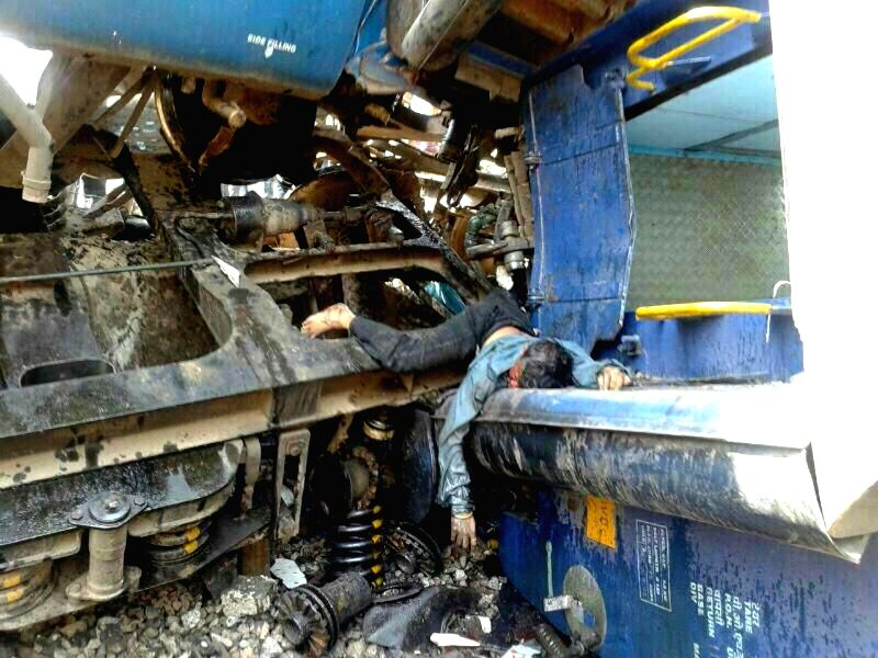 Body of a man who was killed as the  engine and four coaches of Diva-Sawantwadi express were derailed near Nagothana in Raigarh of Maharashtra on May 4, 2014. Nine people were killed in the accident.