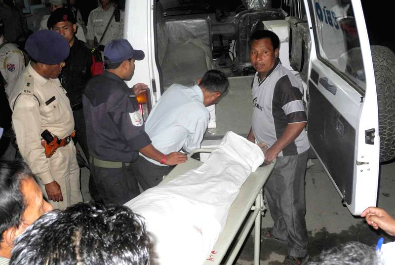 Body of Election Observer Chandrabhanu IAS being taken to morgue after he was declared brought dead at JNIMS in Imphal on April 12, 2014.