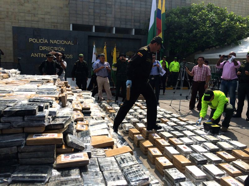 Colombian policemen inspect the seized cocaine packages, in Bogota city, capital of Colombia, on April 10, 2014. Colombian police seized around seven tons of ...
