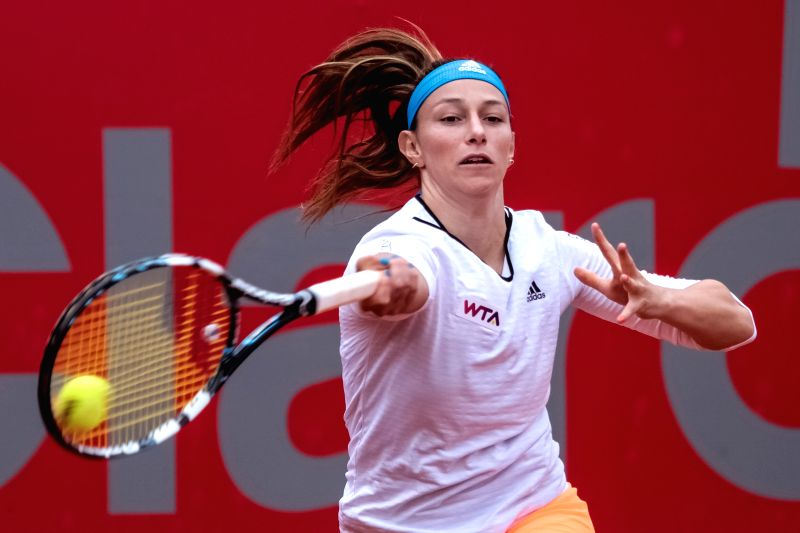 Mariana Duque-Marino of Colombia returns a hit during the quarter-final match against Vania King of the United States at the Claro Open Colsanitas of the Women's ...