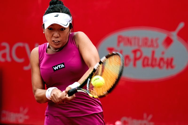 Vania King of the United States returns a hit during the quarter-final match against Mariana Duque-Marino of Colombia at the Claro Open Colsanitas of the Women's ...