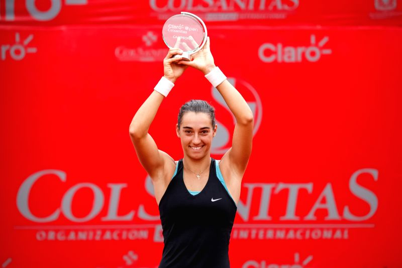 Caroline Garcia of France raises her trophy after winning the final match of the Colsanitas Tenis Cup of the Women's Tennis Association (WTA) against Serbia's ...