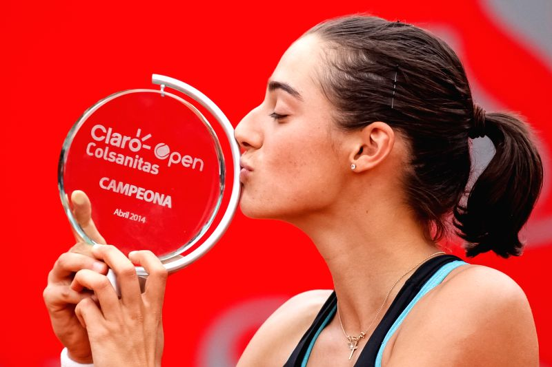 Caroline Garcia of France kisses her trophy after winning the final match of the Colsanitas Tenis Cup of the Women's Tennis Association (WTA) against Serbia's ...