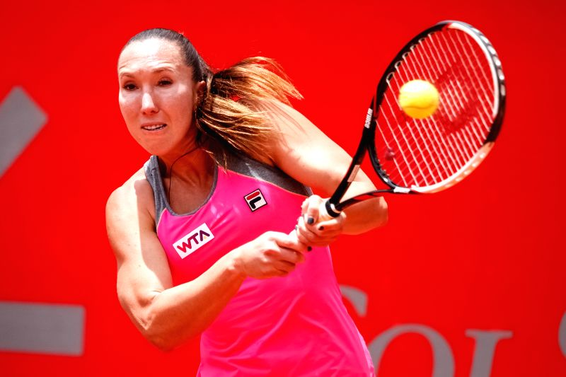 Serbia's Jelena Jankovic returns the ball to Caroline Garcia of France during the final match of the Colsanitas Tenis Cup, of the Women's Tennis Association (WTA), .
