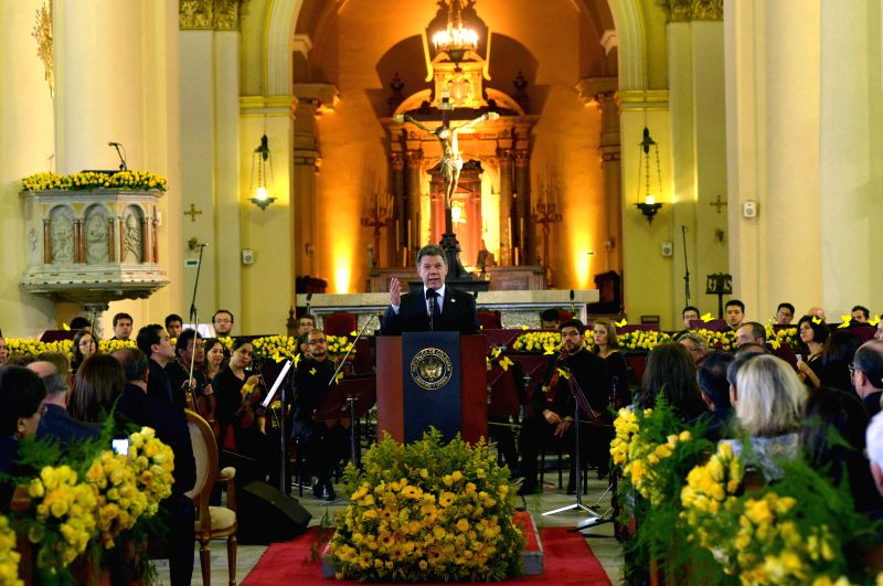 Image provided by Colombia's Presidency shows Colombian President Juan Manuel Santos (C) delivering a speech during the homage of the late Latin American writer ...