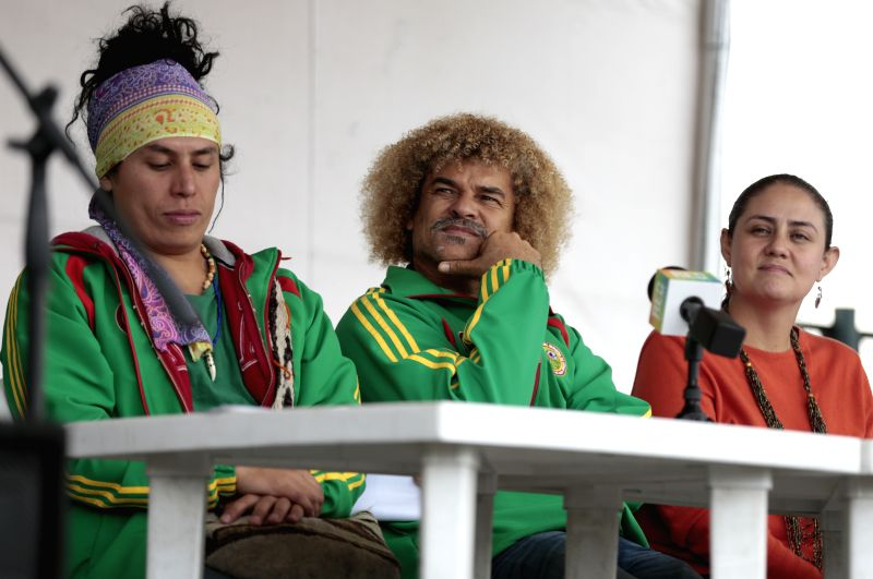 Former soccer player, Carlos Valderrama (C), takes part in a press conference about the first indigenous soccer team of Colombia, in Bogota, Colombia, on April 21, ...