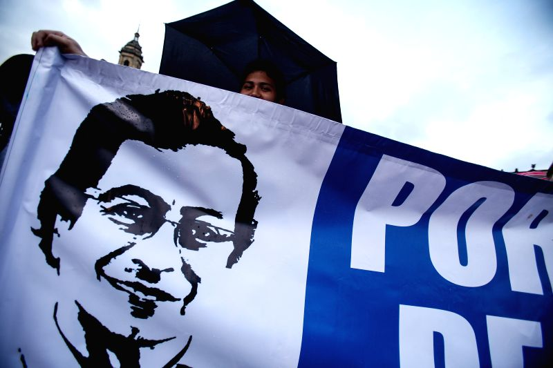 A person holds a banner during a march for the restitution of Bogota's Mayor Gustavo Petro, in Bogota, Colombia, on April 23, 2014. Colombian President Juan Manuel .