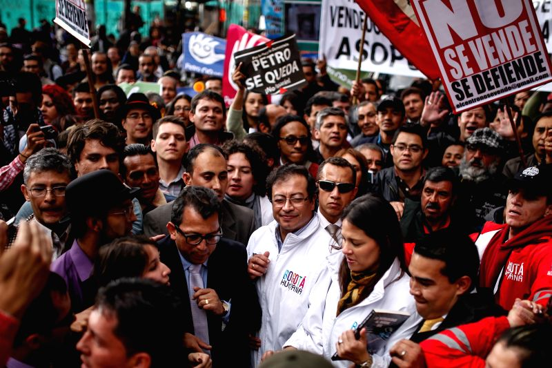 Bogota's Mayor Gustavo Petro (C) takes part in a march for his restitution in Bogota, Colombia, on April 23, 2014. Colombian President Juan Manuel Santos on ...