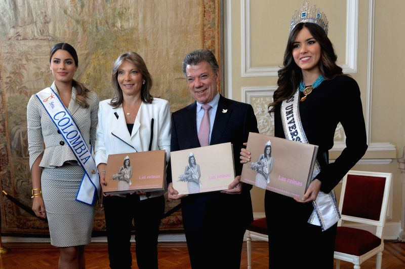 Image provided by Colombia's Presidency shows Colombian President Juan Manuel Santos (2nd R) and First Lady Maria Clemencia Rodriguez (2nd L) posing with Paulina ...