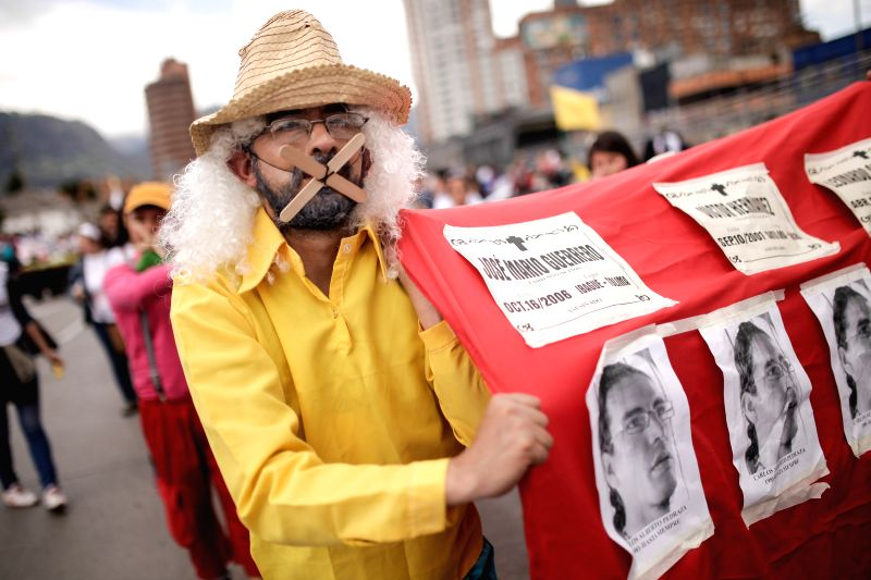 A man takes part in the march for peace, marking the National Day of Memory and Solidarity with the Victims of Armed Conflict, in Bogota, Colombia, on April 9, 2015. ...