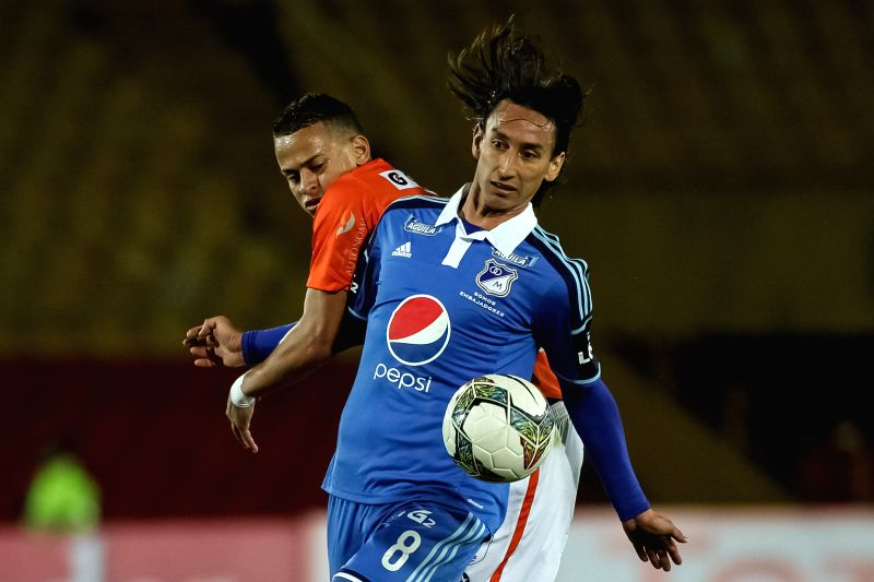 Rafael Robayo (Front) of Millonarios of Colombia vies for the ball with Donald Millan (Back), of Cesar Vallejo of Peru, during their match of the South American Cup,