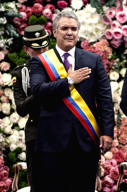 BOGOTA, Aug. 8, 2018 - Colombian President Ivan Duque attends his swearing-in ceremony at Bolivar Square, in Bogota, capital of Colombia, on Aug. 7, 2018.