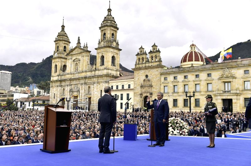 BOGOTA, Aug. 8, 2018 - Image provided by Colombia's Presidency shows Colombian President Ivan Duque (C) attending his swearing-in ceremony at Bolivar Square, in Bogota, capital of Colombia, on Aug. ...